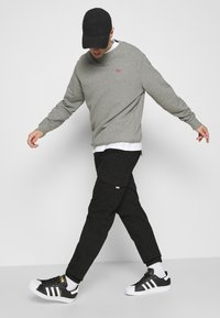 Tommy Jeans - JOGGER - Cargo trousers - black - 3