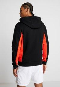 Lacoste Sport - veste en sweat zippée - black/corrida/pitch chine - 2