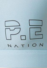 P.E Nation - Sport-bh met medium support - winter sky - 3