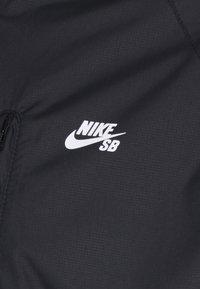 Nike SB - SEASONAL JACKET UNISEX - Summer jacket - black/white - 2