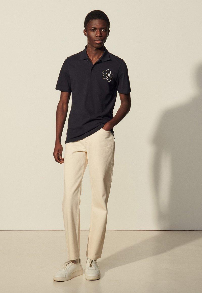 sandro - Polo shirt - marine