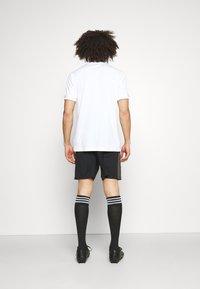 adidas Performance - TIRO PRIDE - Pantaloncini sportivi - black - 2