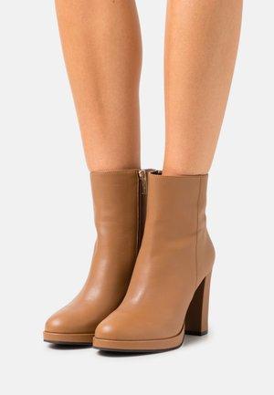 VAYA - Platform ankle boots - cognac