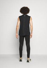 SQUATWOLF - LIMITLESS JOGGERS - Pantalon de survêtement - black - 2