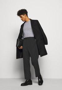 Filippa K - SAMSON TROUSER - Kalhoty - black - 1