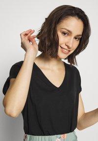 Vero Moda - VMAVA V NECK TEE - Basic T-shirt - black - 4