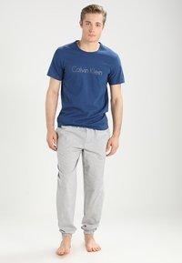 Calvin Klein Underwear - JOGGER - Pyjama bottoms - grey - 1