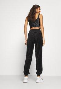 adidas Originals - JOGGER - Pantalon de survêtement - black - 2