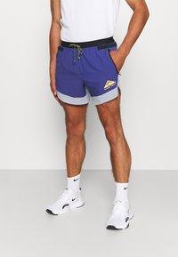 Nike Performance - TRAIL - Outdoorové kraťasy - ghost/purple dust/university gold - 0