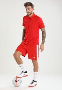 Puma - LIGA SIDELINE  - T-shirt de sport - red/white - 1