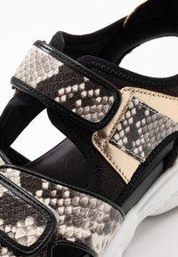 MICHAEL Michael Kors - HARVEY - Platform sandals - nature/black - 2