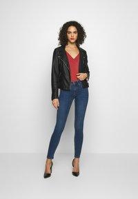 Gina Tricot - BONNIE - Jeans Skinny Fit - dark blue denim - 1