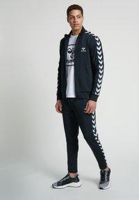 Hummel - Zip-up hoodie - black - 1