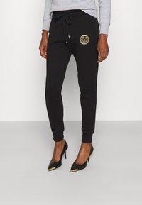 Versace Jeans Couture - PANTS - Tracksuit bottoms - black - 0