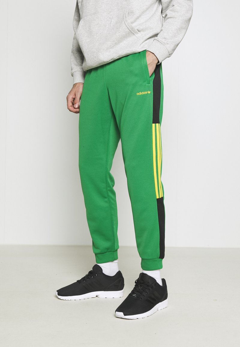 adidas Originals - CLASSICS  - Tracksuit bottoms - green/black