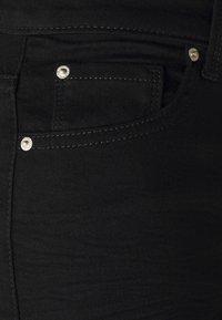 Marks & Spencer London - SLIM - Slim fit jeans - black - 5