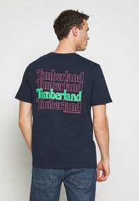 Timberland - KENNEBEC RIVER GRAPHIC TEE - Print T-shirt - dark sapphire - 0