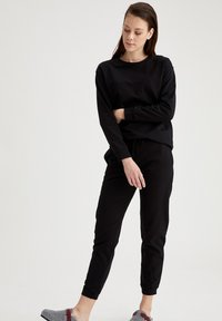 DeFacto - Tracksuit bottoms - black