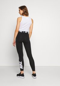 Nike Sportswear - CLUB  - Leggings - Trousers - black/white