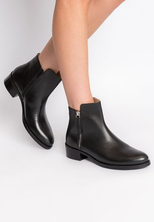 MACCHIE - Classic ankle boots - black