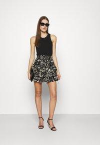 NIKKIE - RUFFLE SKIRT - Mini skirt - black - 1