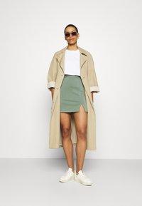 Zign - Mini princess seams skirt high waisted with slit - Pencil skirt - light green - 1