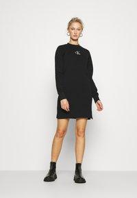 Calvin Klein Jeans - CUT OUT BACK DRESS - Day dress - black - 1