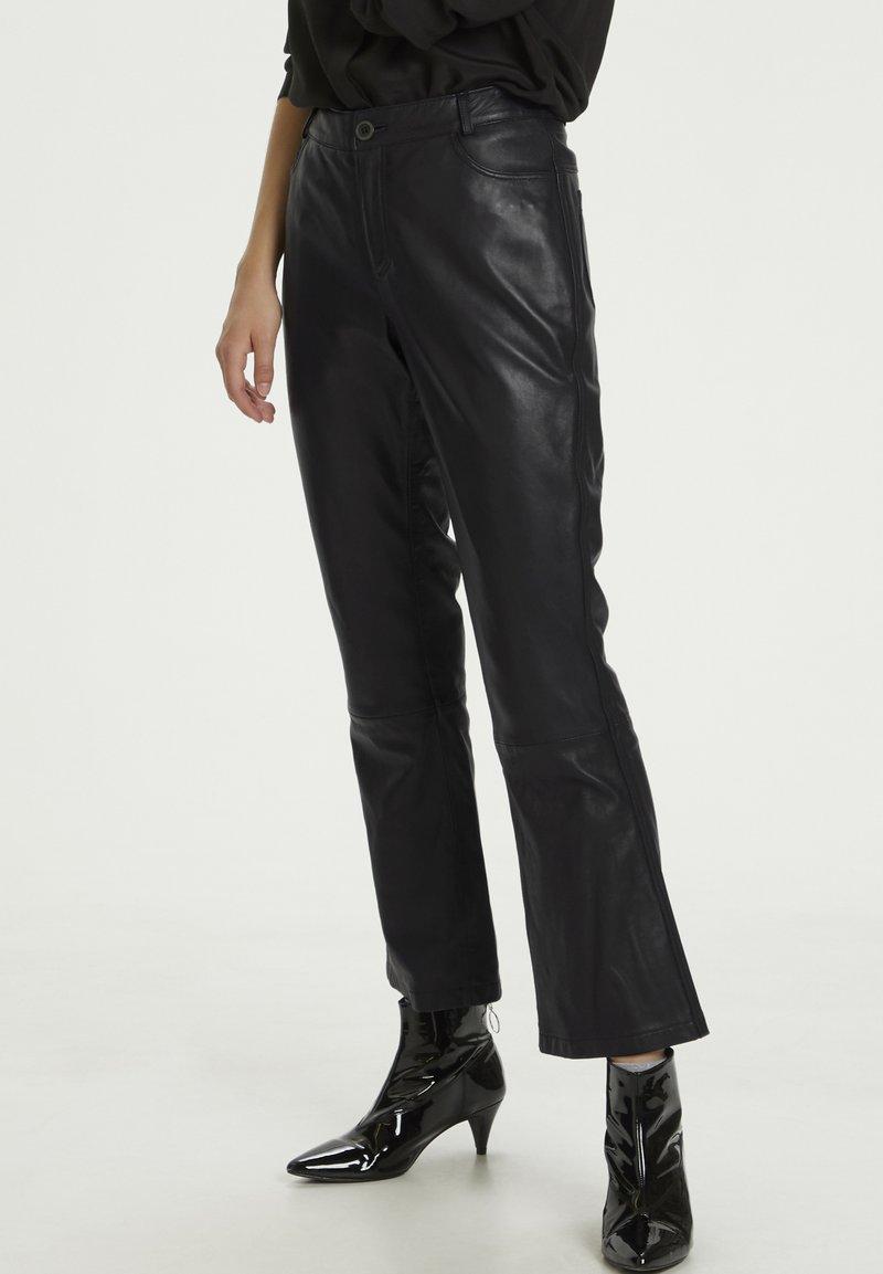 Denim Hunter - HUNTER DHTWIGGY  - Leather trousers - black