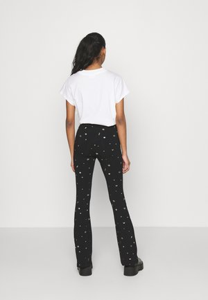 STAR EYE PRINT BASIC FLARE PANTS - Trousers - black