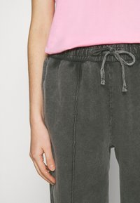 Topshop - ACID WASH  - Tracksuit bottoms - charcoal - 6