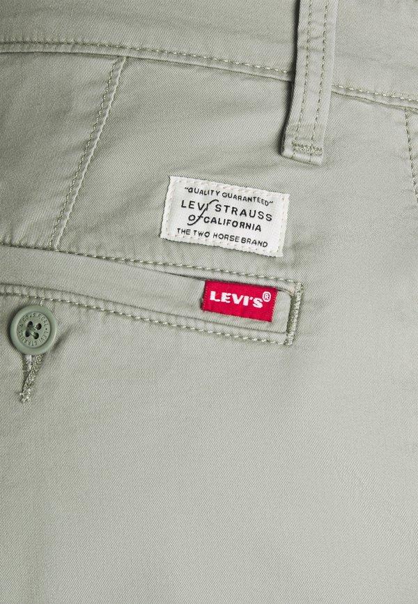 Levi's® SLIM - Chinosy - greens/jasnozielony Odzież Męska XCLG