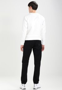 Carhartt WIP - KLONDIKE PANT MAITLAND - Straight leg jeans - black rinsed - 2