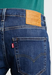 Levi's® - 502™ REGULAR TAPER - Straight leg jeans - crocodile adapt - 5
