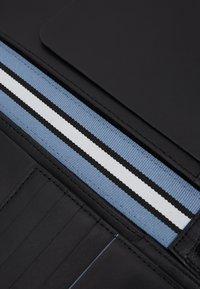 Calvin Klein - TRAVEL LONG WALLET - Lompakko - black - 2