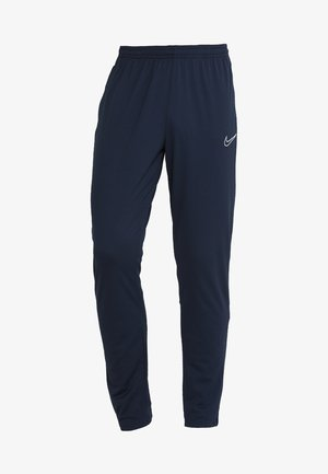 DRY ACADEMY - Tracksuit bottoms - obsidian/white/white
