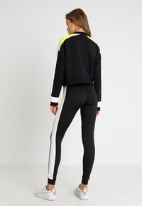 Puma - CHASE CREW - Long sleeved top - black - 2