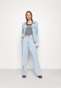 Calvin Klein Jeans - STRIPES BABY TEE - Print T-shirt - black/white - 1