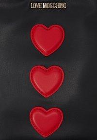 Love Moschino - PHONE CROSSBODY EXCLUSIVE - Schoudertas - black - 4