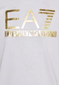 EA7 Emporio Armani - Print T-shirt - white/gold - 7