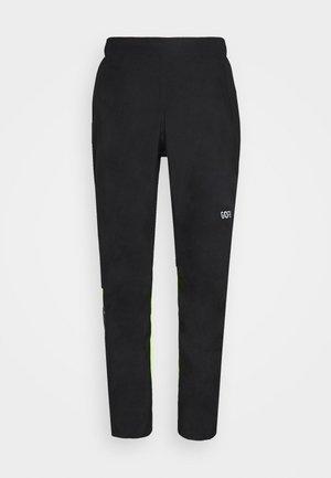 GORE® C3 GORE-TEX PACLITE® - Pantalon classique - black/neon yellow