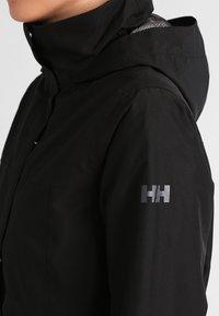 Helly Hansen - ADEN INSULATED COAT - Outdoor jacket - black - 4