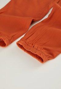 DeFacto - Tracksuit bottoms - orange - 3
