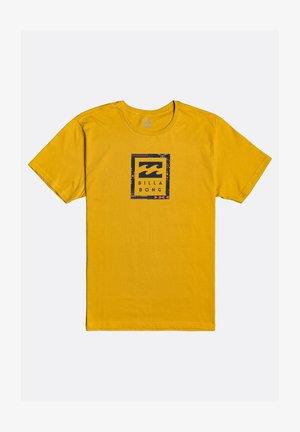 UNITY STACKED - Print T-shirt - mustard