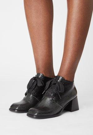 VELIA - Ankle boots - black