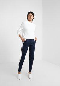 HUGO - HERANI - Trousers - open blue - 1