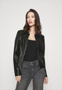 Vero Moda - VMBUTTERALBA COATED JACKET - Faux leather jacket - black - 0