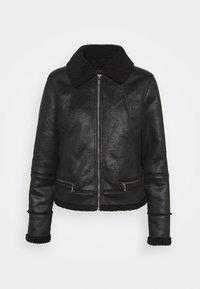 FAUX SHEARLING MOTO - Light jacket - black