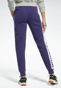 Reebok - LINEAR LOGO FRENCH TERRY JOGGERS - Tracksuit bottoms - purple - 1