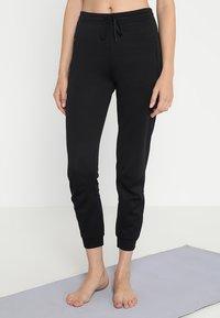 Filippa K - SHINY TRACK PANTS - Teplákové kalhoty - black - 0