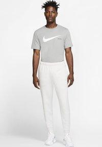 Nike Sportswear - CLUB - Tracksuit bottoms - vast grey/white - 1